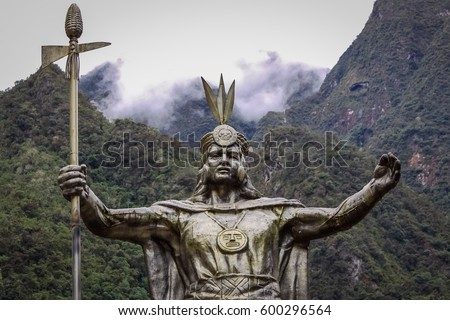 Statue of Pachacuti, an Inca leader, background mountains and clouds, in Aguas Calientes, starting point to Machu Picchu, Peru