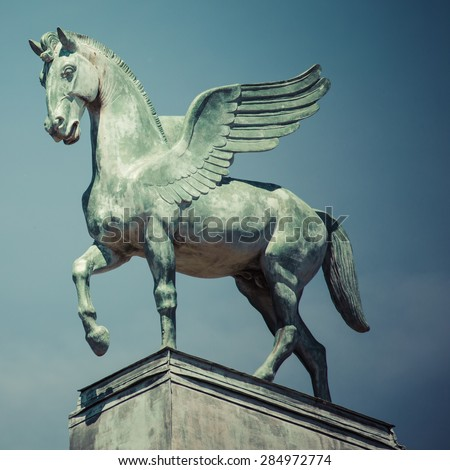 statue of pegasus on the roof of opera in poznan poland - stock photo