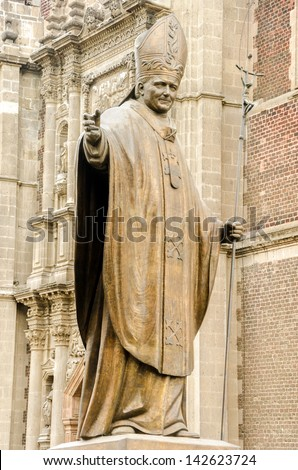 Statue of Pope John Paul II in Mexico City near the Basilica of Our Lady of Guadalupe - stock photo