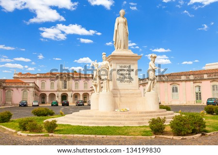 Statue of Queen Maria I of Portugal with the entrance of the National Palace of Queluz as background, Municipally of Sintra, Lisbon district, Portugal - stock photo