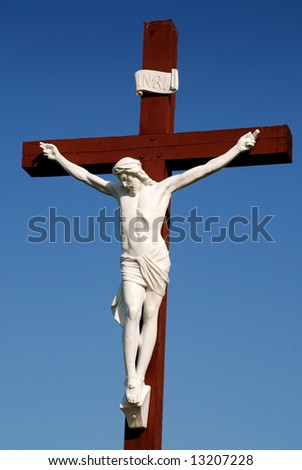 Statue of redeemer Jesus Christ on wood cross