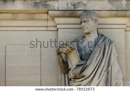 statue of Roman man reading a scroll