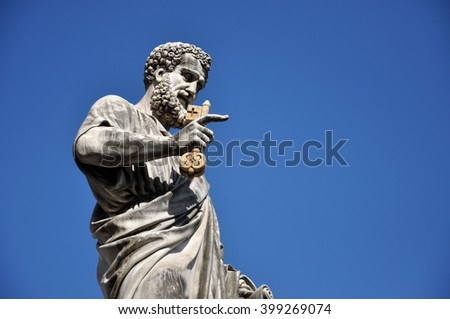Statue of Saint Peter holding a key. Vatican city