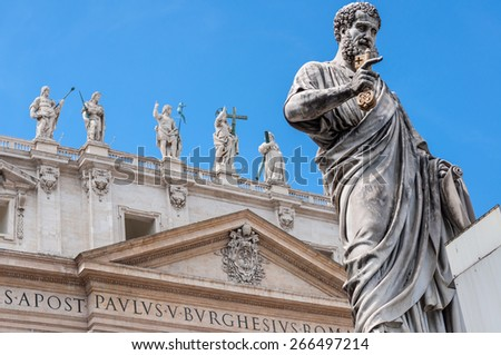 Statue of Saint Peter with golden key, Saint Peter's Basilica at background in St. Peter's Square, Vatican City, Rome, Italy - stock photo