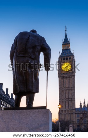 Statue of Sir Winston Churchill, looking towards Westminster Palace, Houses of Parliament, Elizabeth Tower, Big Ben, at Sunrise. London, England, UK. - stock photo