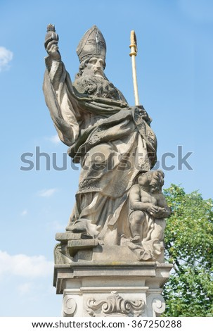 Statue of St. Augustine d'Ippona of 1708 on Charles Bridge - Prague - stock photo
