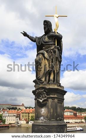 Statue of St. John the Baptist. Charles Bridge in Prague. Czech Republic. - stock photo
