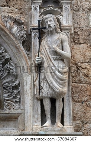 Statue of St. John the Baptist on the portal of the Franciscan church of the Friars Minor in Dubrovnik - stock photo
