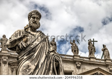 Statue of St. Peter with the key before the cathedral of San Pietro, Vatican City - stock photo