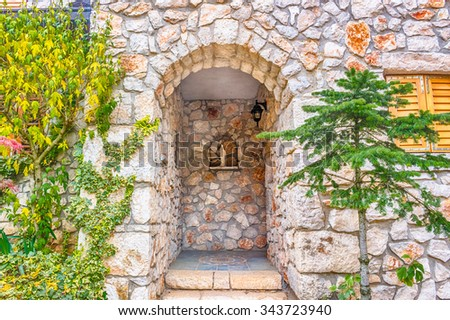 Statue of the Blessed Virgin Mary with Baby Jesus on stone walls - stock photo