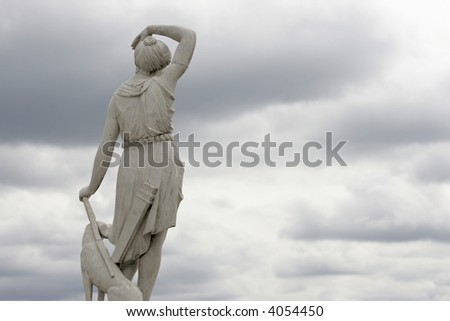 Statue of the girl with a dog - stock photo