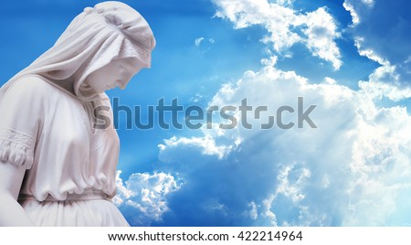 Statue of the mother of Jesus Christ over blue sky background panoramic view - stock photo