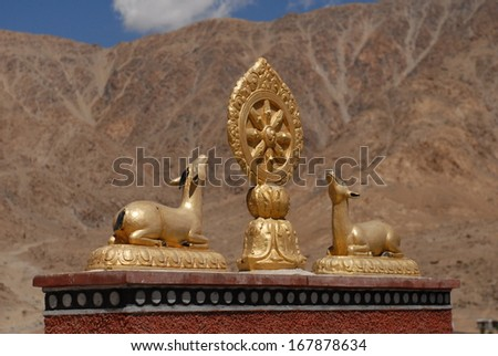 Statue of two golden deer on the gateway to Pyang Monastery in Ladakh - stock photo