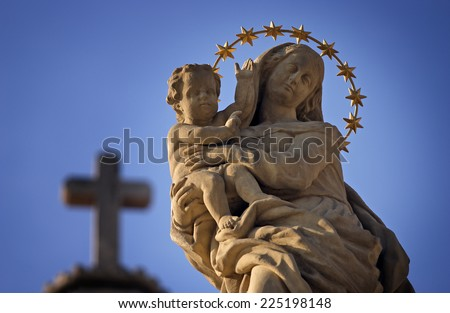 Statue of Virgin Mary and Jesus from the cross sky background - stock photo
