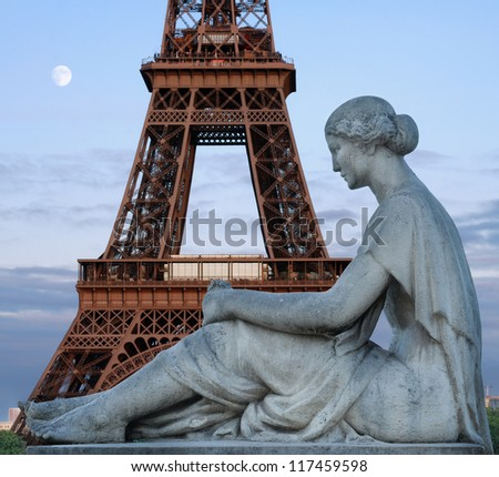 Statue of waiting woman on Trocadero and Eiffel tower in Paris, France. - stock photo