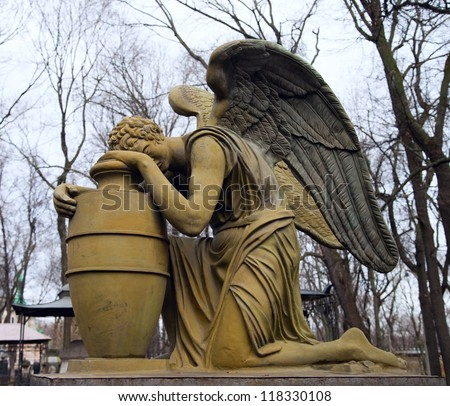 Statue of weeping angel, necropolis of Donskoy monastery, Moscow, Russia - stock photo