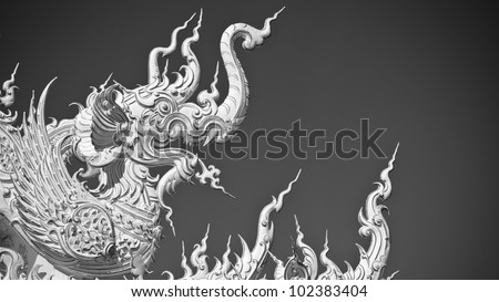 Statue of white dragon in Wat Rong Khun. Wat Rong Khun is a contemporary unconventional Buddhist temple in Chiang Rai, Chiangmai province, Thailand. It is designed in white color.