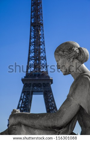 Statue of woman at the Trocadero with Tour Eiffel - stock photo