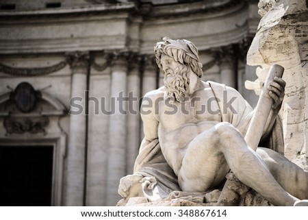 Statue of Zeus in Fountain, Piazza Navona, Rome, Italy - stock photo