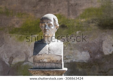 Statue of Zeusi in Rome, Italy In a park on a hill above city center of Rome, there are many statues - busts of important personalities. One of them is bust of antique greek painter.  - stock photo