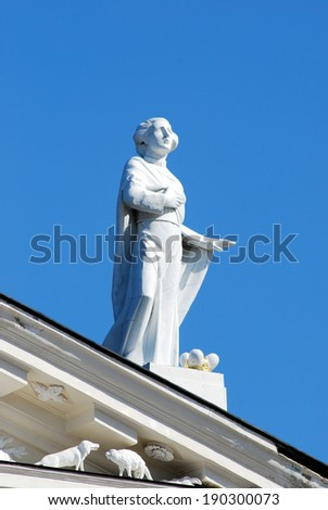Statue on cathedral in Vilnius city and blue sky. Lithuania.