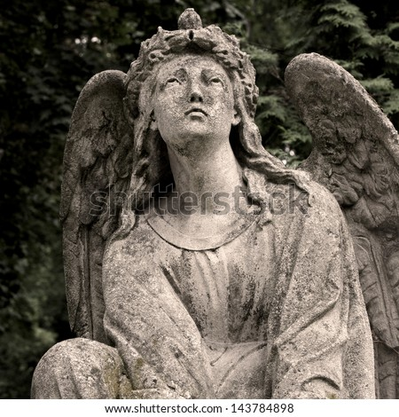 Statue on grave in the cemetery of Lviv, Ukraine.