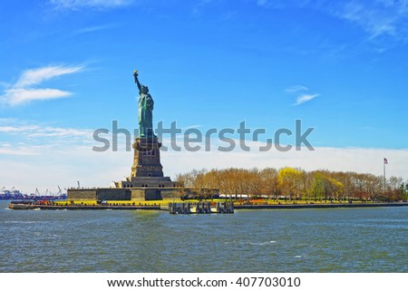 Statue on Liberty Island. New York City, USA. In Upper New York Bay. Tourists are walking on the island. - stock photo