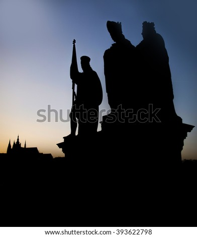 Statue on the Charles Bridge (Karluv most, 1357), a famous historic bridge that crosses the Vltava River in Prague, high contrast concept, sunset