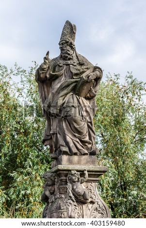 Statue on the Charles Bridge (Karluv most, 1357), a famous historic bridge that crosses the Vltava River in Prague, Czech Republic. Bridge is decorated by 30 statues, originally erected around 1700. - stock photo