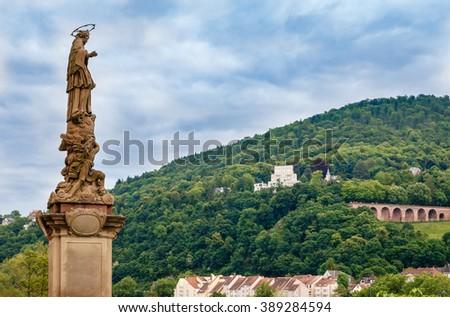 Statue on the Old Bridge of Heidelberg; Germany - stock photo