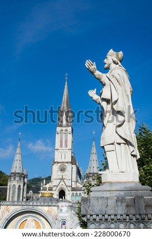 Statue on the square of the cathedral, Lourdes, France - stock photo