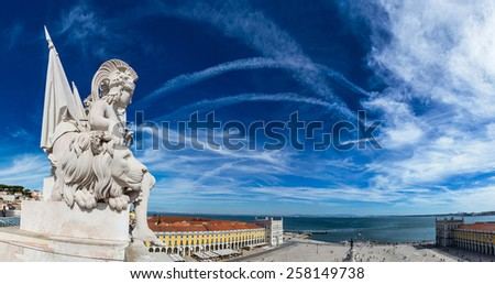 Statue on triumphal augusta arch in Lisbon in a beautiful summer day - stock photo