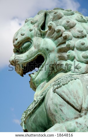 Statue outside buddist temple - stock photo