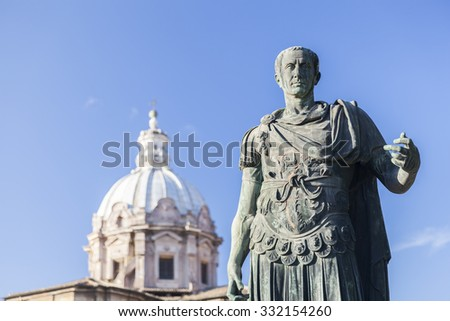 Statue Roman Emperor in front of church in Rome, Italy - stock photo
