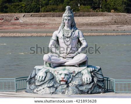 Statue Shiva, hindu idol on the river Ganges, Rishikesh , India . Close up - stock photo