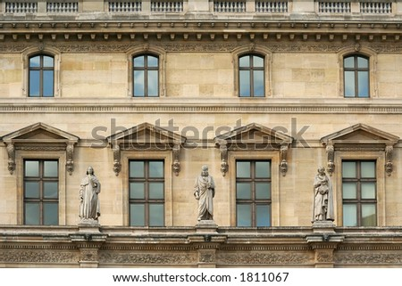 Statues and windows on the front wall of Pavillon Richlieu, inside the Louvre museum - Paris, France