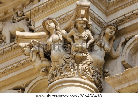 Statues at the Basilica of Santa Croce or Church of the Holy Cross, a famous baroque church in Lecce, Apulia, Southern Italy.  - stock photo
