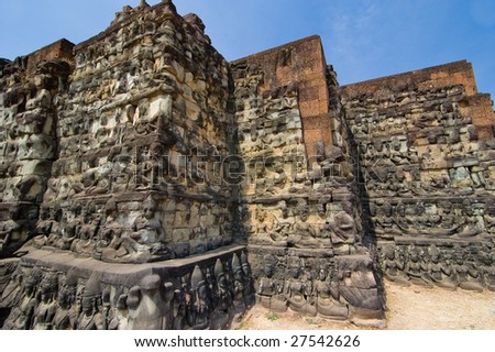 Statues carved along corners of Leper king terrace at Angkor Thom, Cambodia