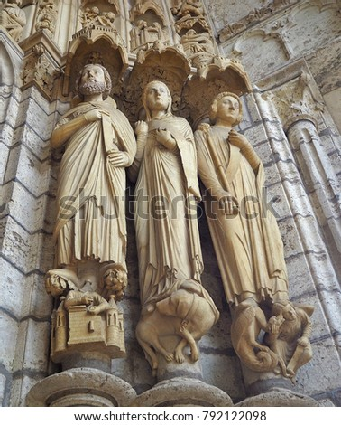 Statues (details) at Cathedrale Notre Dame de Chartres, a medieval old Catholic cathedral in Chartres, France