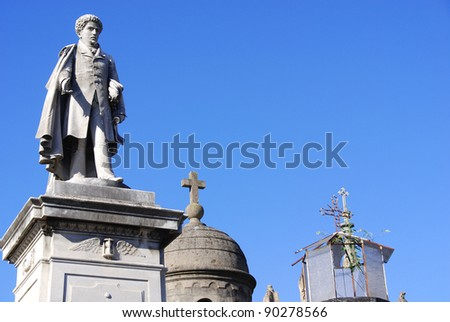Statues in La Recoleta Cemetery is a famous cemetery located in the exclusive Recoleta neighbourhood of Buenos Aires, Argentina. It contains the graves of notable people, including Eva Perón. - stock photo