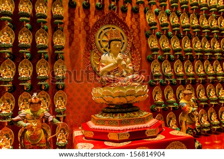 Statues inside a Buddhist temple in Singapore - stock photo