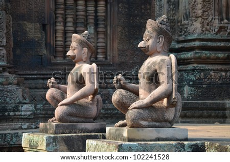 Statues inside the temple of Banteay Srei. Angkor. Cambodia - stock photo