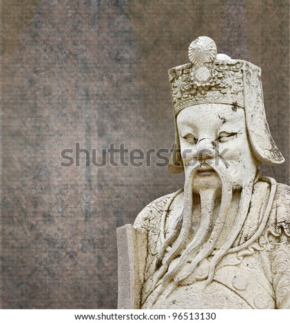 Statues of ancient China with background old walls