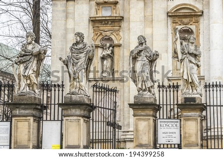 Statues of 12 apostles. Roman Catholic Church of Saints Peter and Paul (Kosciol swietego Piotra i Pawla, was built 1597 - 1619) in Baroque style. Old Town district of Krakow, Poland. - stock photo
