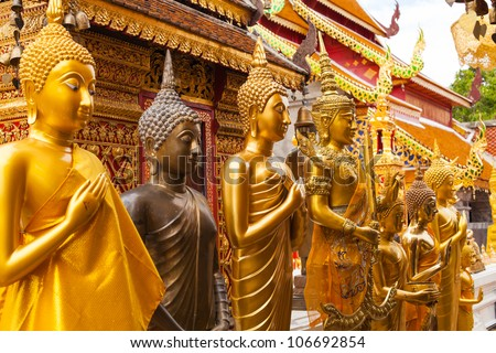 Statues of Buddha in a temple Doi Suthep, Chiang Mai, Thailand - stock photo