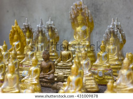 Statues of Buddhist monks. selective focus - stock photo