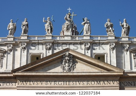 Statues of Christ, John the Baptist, and some apostles on the top of Saint Peter Basilica facade. Rome, Italy - stock photo