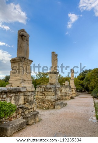 Statues of Giants and Tritons in the Ancient Agora of Athens (from the Odeon of Agrippa), Greece - stock photo