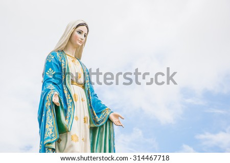 Statues of Holy Women on cloudy sky background - stock photo