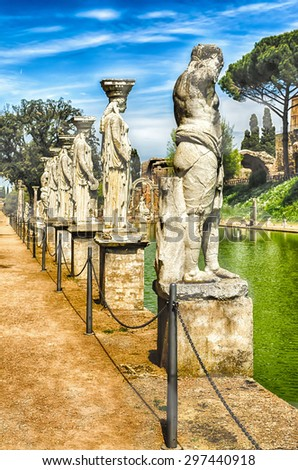 Statues of the Caryatides overlooking the ancient pool called Canopus at Villa Adriana (Hadrian's Villa), Tivoli, Italy - stock photo